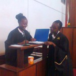 The girls try on the lawyer's gowns, in court