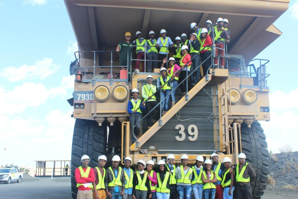 Students pose next to a 793 CAT truck which can hold up to 235 tonnes in a single load